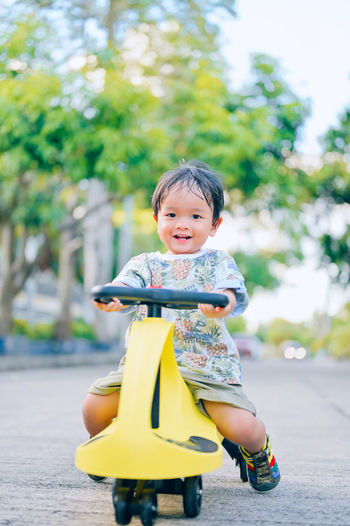 Portrait of cute boy riding motorcycle