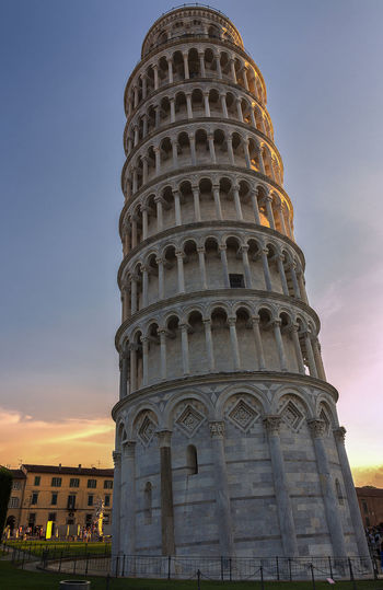 close up of the leaning tower in pisa Ancient Civilization Architecture Belief Building Building Exterior Built Structure City Close Up Gothic Style History Leaning Tower Leaning Tower Of Pisa Low Angle View Nature No People Religion Sky Sunset Sunsets Tall - High The Past Tourism Tower Travel Travel Destinations