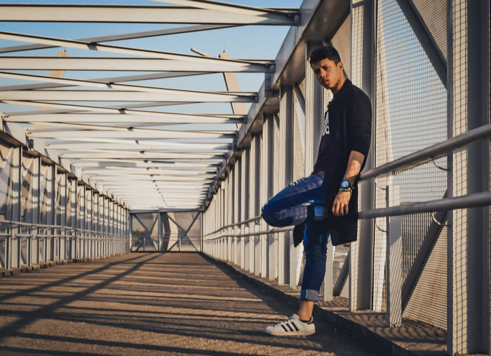 Full length of man standing at bridge