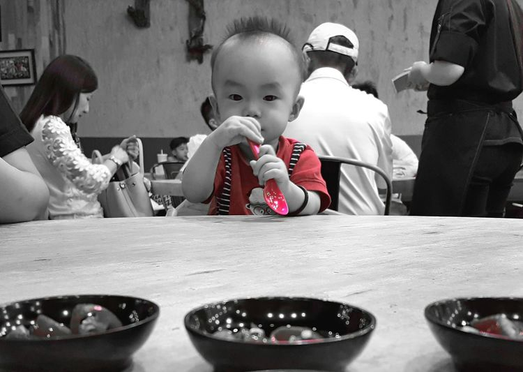 A boy in the restaurant Child People Indoors  Boy Lunch Restaurant Fresh On Eyeem  Showcase January Hello World The Week Of Eyeem Check This Out My Point Of View Personal Perspective Looking At Camera Outing Playing With Spoon Uniqueness The Portraitist - 2017 EyeEm Awards Place Of Heart