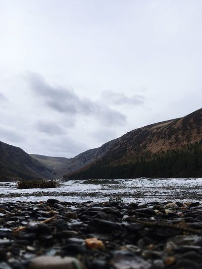 The upper lake waves, Ireland 🇮🇪 2019 IPhoneography Glendalough Ireland Sky Cloud - Sky Cold Temperature Winter Beauty In Nature Snow Scenics - Nature Non-urban Scene Tranquil Scene Mountain Environment Waterfront Outdoors Snowcapped Mountain No People Water Tranquility Day Nature