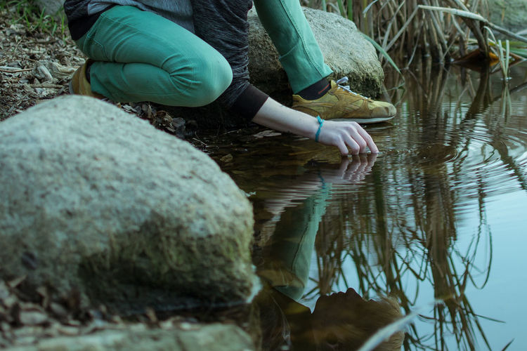 Water Rock Nature Rock - Object Lake Day One Person Solid Real People Women Adult Casual Clothing Leisure Activity Reflection Lifestyles Depression - Sadness Depression Autumn