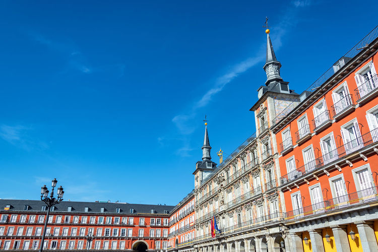 Low angle view of plaza mayor against clear blue sky