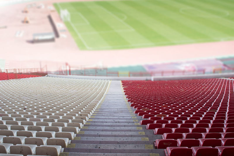 red and white seats at the stadium Seats Stadium Red Lipstick White Rows Plastic Detail Pattern Background Sport Soccer Football Game Architecture Team Seating Nobody Event Public Empty Chairs Stairs Field Section Grass