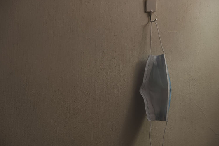 Close-up of clothes drying on wall