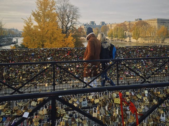 November in Paris. Love locks on the Pont Neuf Real People Bridge - Man Made Structure Autumn Built Structure Tree Lifestyles Architecture Outdoors Day Building Exterior Sky City Nature People Railing Paris France Pont Neuf Love Lock Love Locks Love Locks Bridge Love Locks On Bridge Railings Love Lock Bridge Love Locked Paris, France  Be. Ready. Stories From The City This Is Family