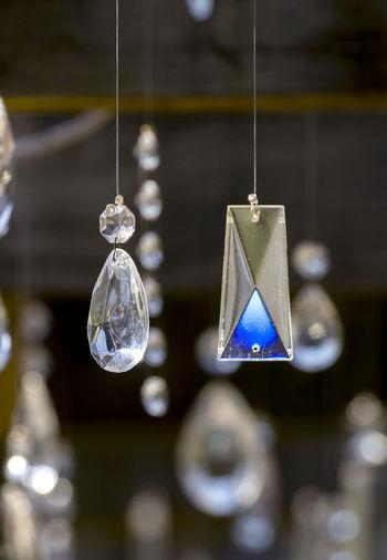 Close-up of illuminated lighting equipment hanging on christmas lights