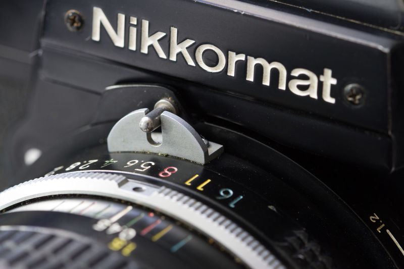 50mm Nikkormat FT2 Nikon Camera - Photographic Equipment Close-up Day Nikkor Nikkormat No People Outdoors Photography Themes Technology Text