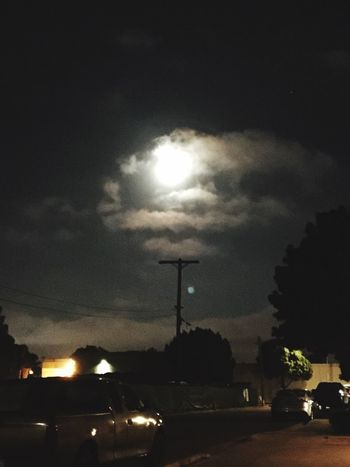 The sky in all its glory brings such beauty to its viewers who take the time to stop and enjoy it... Cloud - Sky Illuminated Night Street Light No People Road Outdoors Storm Cloud Nature Live For The Moment  Art In Everything Best Eyeem Pics First Eyeem Photo EyeEm Best Shots Eyeem Market Showcase:June Full Moon Tranquil Scene Dark Tranquility