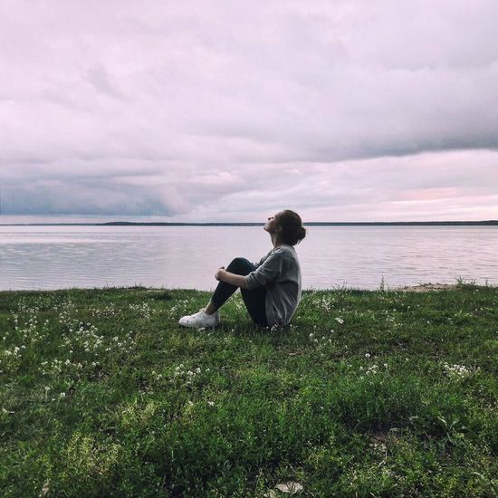 Grass Water Leisure Activity Sitting Cloud - Sky Lifestyles Casual Clothing Relaxation Beauty In Nature Non-urban Scene Vacations Naroch Lake Naroch Belarus Girl Girl Sitting On Grass Girl Sitting Alone Calmness Grass Water Rear View Tranquil Scene Leisure Activity Sky Sitting