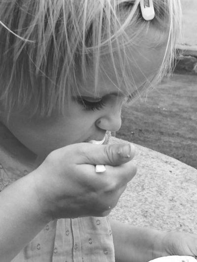 Toddler Girl Eating Outdoors
