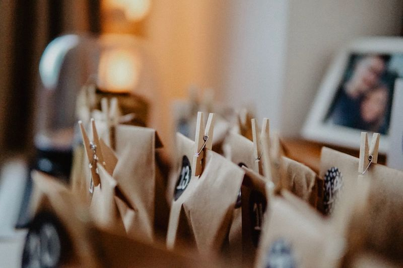 Close-up of paper bags with clothespins