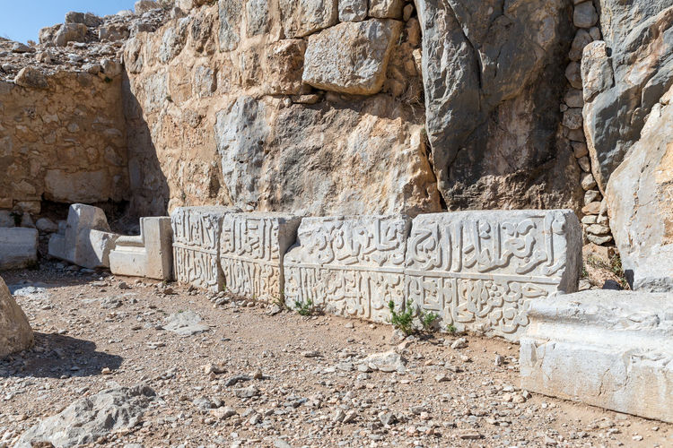 Several large stones with embossed inscriptions in Arabic in Nimrod Fortress located in Upper Galilee in northern Israel on the border with Lebanon. History Israel Nimrod Fortress Castle Border Stone Material Wall - Building Feature Saladin Beybars Crusaders Ayubids Mamluks Assassins Tower Heritage Travel Destinations National Park Hill Old Ancient Architecture Medieval Ruin Protection Fort Gate