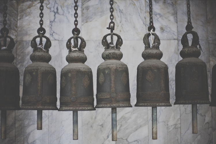 bells aligned at a Buddhist temple in Thailand Arranged Arrangement Bell Buddhism Buddhist Temple Collection Group Of Objects In A Row No People Order Repetition Side By Side Textures And Surfaces Weathered
