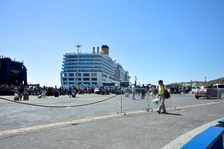 panoramic view of port with Costa Deliziosa cruise ship moored in the new port of Mykonos and people ready to embark Sky Crowd Clear Sky Group Of People Large Group Of People Real People Men Nature Blue Day Women Sunlight Adult Outdoors Costa Deliziosa Costa Crociere Mykonos,Greece Embarkation Harbor Moored Cruise Ship Cruise Cruising Transportation Lifestyles