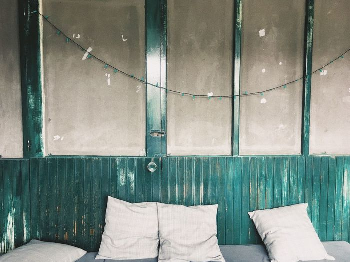Cushions against wall