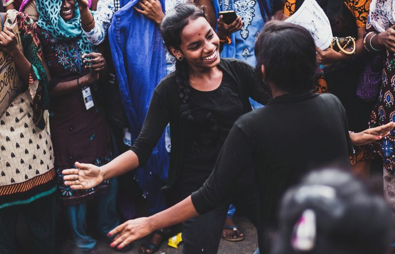 High angle view of smiling women performing on street