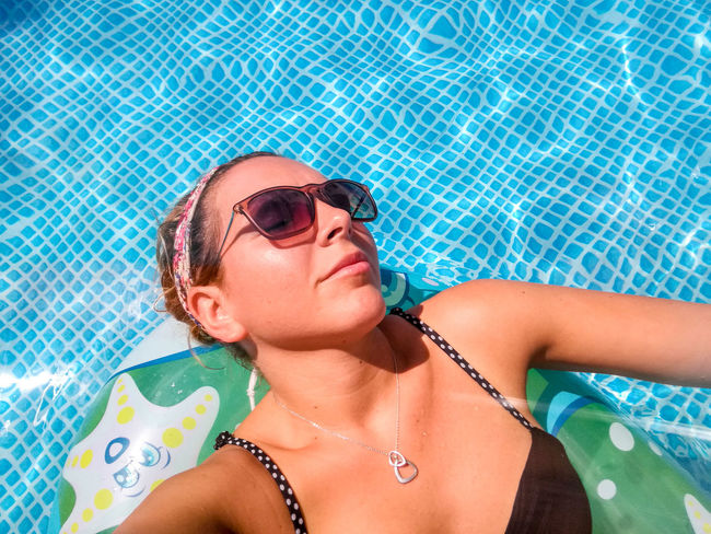EyeEm Selects Swimming Pool Only Women Water One Woman Only Summer Vacations Adults Only Adult Bikini People Beautiful People One Person Outdoors Day Portrait Young Women Young Adult Relaxing In The Sun Relaxing Women Sommergefühle Love Yourself EyeEmNewHere
