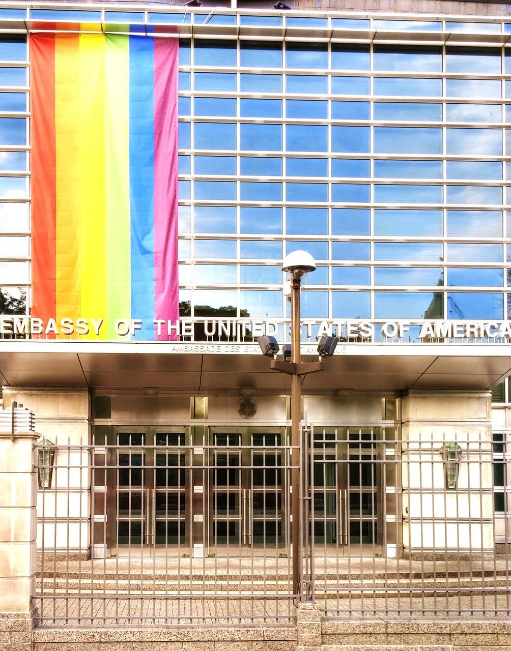window, text, flag, no people, built structure, day, building exterior, architecture, outdoors, multi colored, close-up