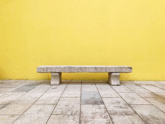 Bench and yellow wall Footpath Architectural Detail Minimalism Yellow Bench Wall - Building Feature Outdoors Copy Space Building Exterior Seat Stone The Minimalist - 2019 EyeEm Awards The Mobile Photographer - 2019 EyeEm Awards