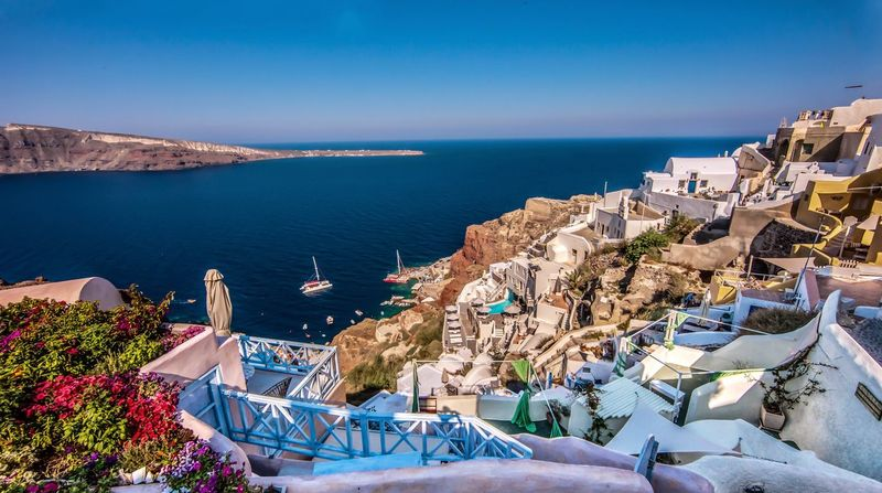 Santorini colors Sea High Angle View Water Chair Outdoors Blue Sun Lounger No People Table Architecture Nature Horizon Over Water Day Building Exterior Tranquility Scenics Sky Beauty In Nature Place Setting EyeEmNewHere