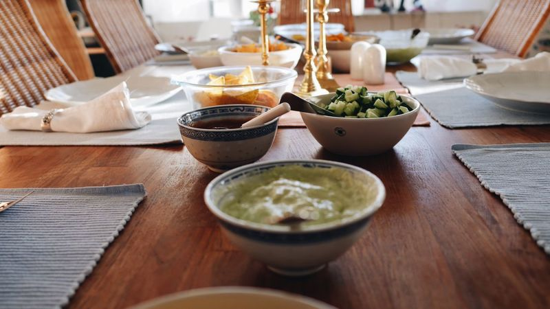 Food And Drink Table Indoors  Bowl Food Healthy Eating Vegetable Freshness Ready-to-eat No People Plate Day Close-up DIP Dinnertime Focus On Foreground Tabletop Ingredients Dinner Table Food And Drink Preparation  Bowls Corn Guacamole Table Setting