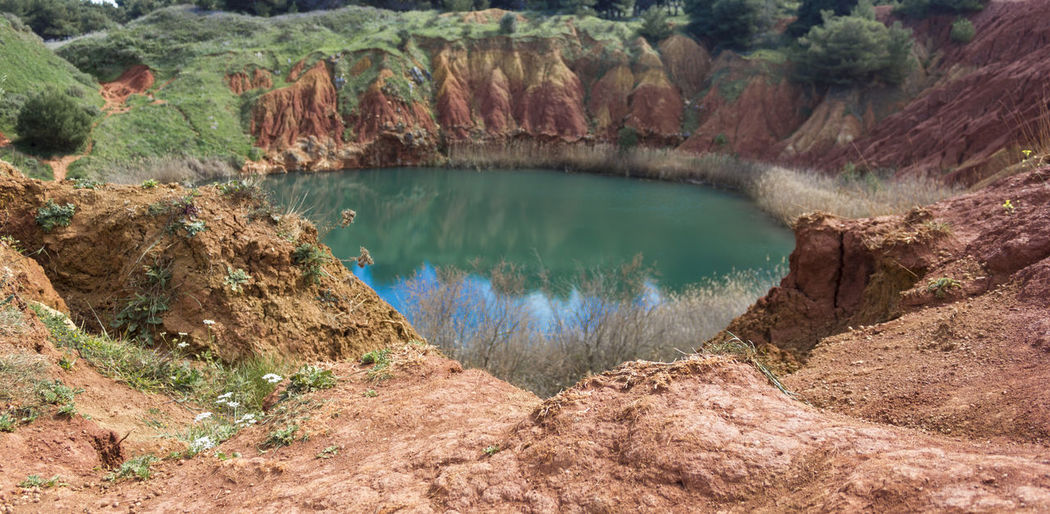 Bauxite Bauxite Cave Bauxite Quarry Beauty In Nature Geology High Angle View Lake Nature Outdoors Physical Geography Rock - Object Rock Formation Scenics Water first eyeem photo