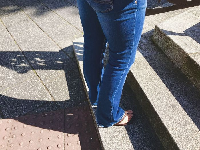 Legs Stood On Steps Low Section Sunlight Shadow Jeans Human Leg Casual Clothing Standing Day Outdoors Lifestyles Adult Out For The Day Town Square The Week On EyeEm