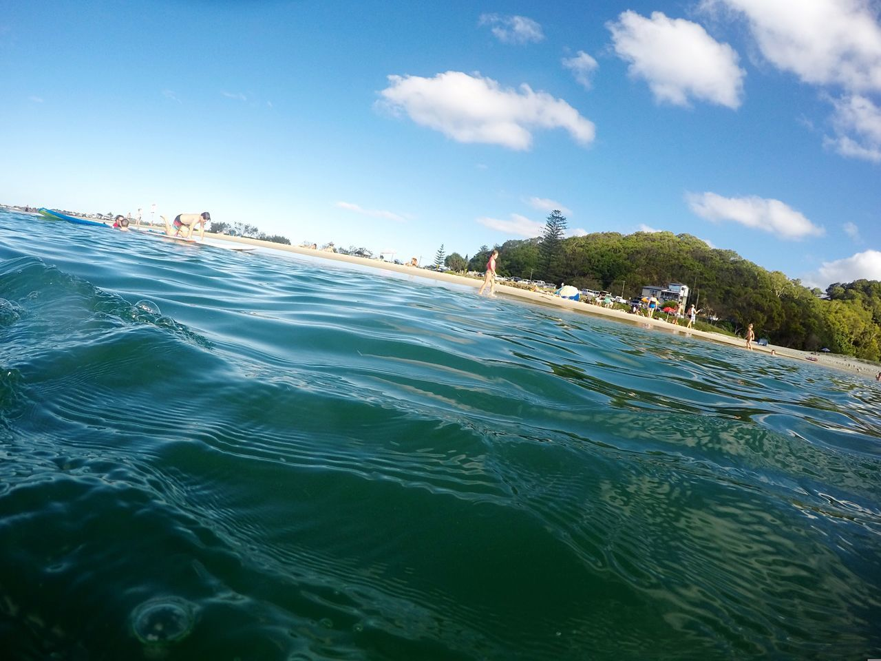 water, sky, fun, vacations, leisure activity, nature, outdoors, real people, motion, adventure, day, men, enjoyment, large group of people, river, lifestyles, beach, blue, scenics, beauty in nature, group of people, women, extreme sports, water slide, people