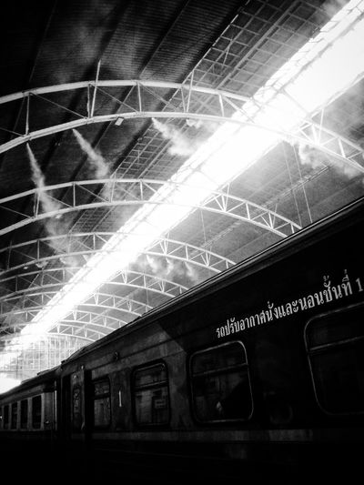 At the train station Bangkok Thailand Travel Train Station Train Train Station Platform Train Station In Black And White Train Station Thailand Train Station Bangkok Black And White Black & White Black And White Photography Black & White Photography Light Play Hangar Leading Lines Lines & Curves Lines And Lights Thai Train Thailand Travel Travel Photography Traveling Traveling By Train EyeEm Thailand Lines And Shadows