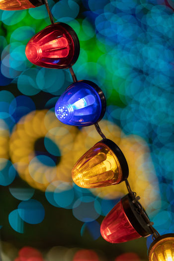 Multi Colored Illuminated Lighting Equipment Decoration Close-up No People Focus On Foreground Hanging Celebration Blue Sphere Shape Low Angle View Design Electricity  Glowing Holiday Indoors  Pattern Glass - Material Christmas Ornament