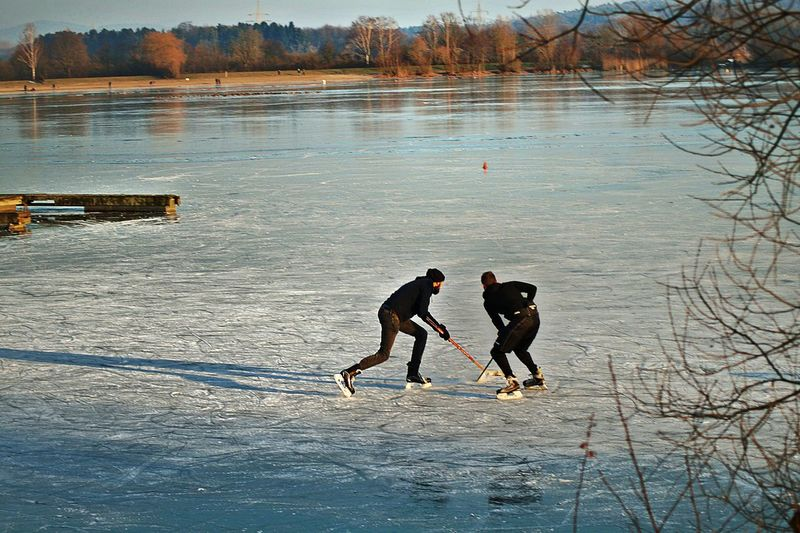 Winter Fun On The Ice Two Men Playing Ice Hockey Sunny Winter Day Frozen Lake Lake View Beach In The Background Winterbeach Landscape The Story Behind The Picture Enjoying Life Nature Winter Cold Temperature Beauty In Nature Outdoors Kinzigsee Langenselbold Germany🇩🇪 Uniqueness Every Picture Tells A Story Done That.