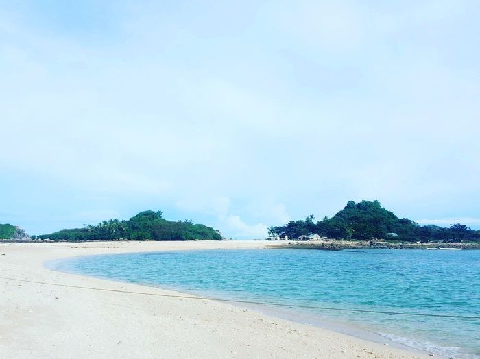Sandbar Beach Sea Island Sand Turquoise Colored Tropical Climate Coastline Idyllic Water Nature Tranquil Scene Vacations Scenics Tranquility Tree Summer Tourist Resort Blue Beauty In Nature Travel Destinations White Sand Beach Adventure Philippines Nature Vacations