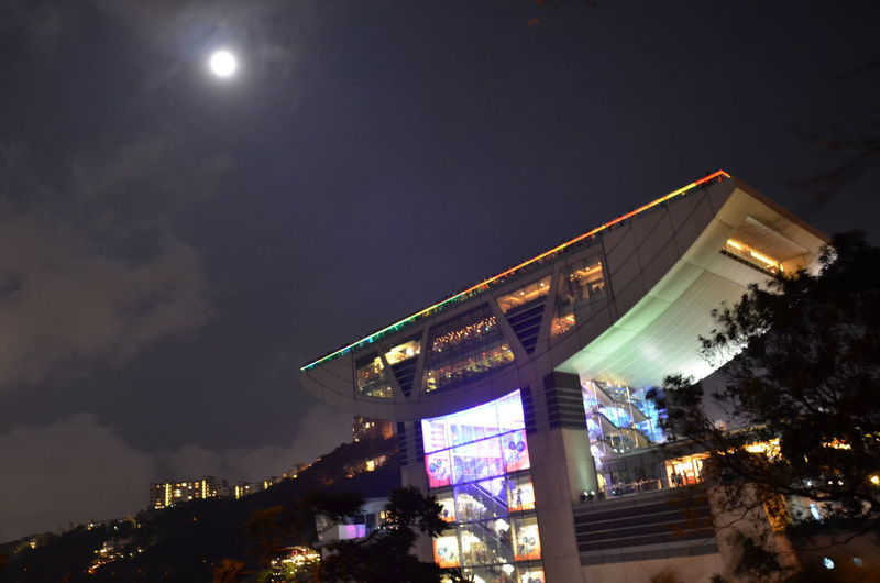 Hong Kong Peak Hong Kong Night View The Peak Tower, Hong Kong Architecture Arts Culture And Entertainment Building Building Exterior Built Structure City Cloud - Sky Communication Dusk Illuminated Lighting Equipment Low Angle View Moon Nature Night No People Outdoors Plant Sky Tree