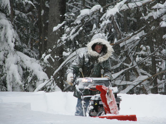 Adult Cold Temperature Day Full Length Nature One Man Only One Person Outdoors Parka People Snow Snowblowing Tree Warm Clothing Weather Winter