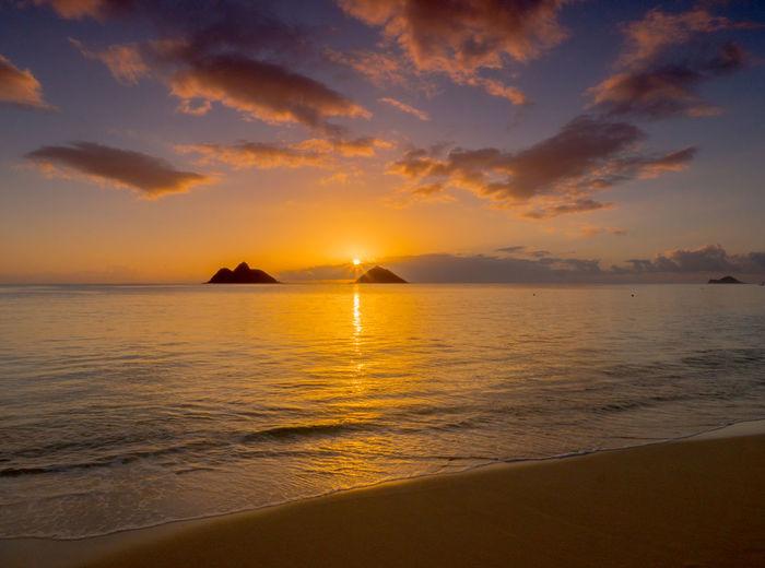 Sunrise at Lanikai Beach on Oahu, Hawaii Beauty In Nature Cloud - Sky Day Dramatic Sky Hawaii Horizon Horizon Over Water Lanikai Beach Nature Nautical Vessel No People Outdoors Reflection Sailing Ship Scenics Sea Sky Sun Sunbeam Sunlight Sunset Tranquil Scene Tranquility Travel Destinations Water