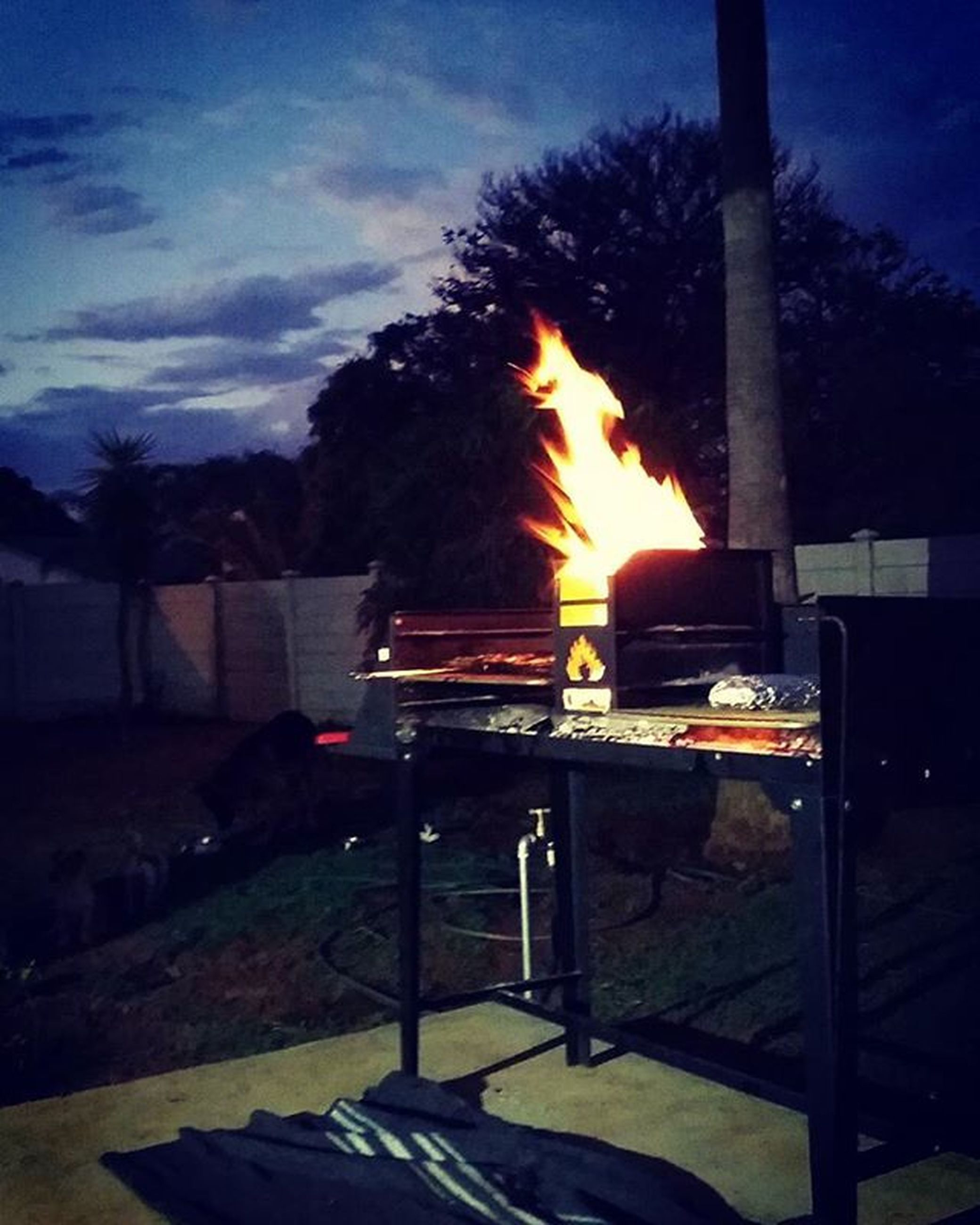 flame, burning, fire - natural phenomenon, heat - temperature, glowing, sunset, fire, night, firewood, bonfire, wood - material, sunlight, illuminated, orange color, sunbeam, sun, dark, silhouette, outdoors, bench