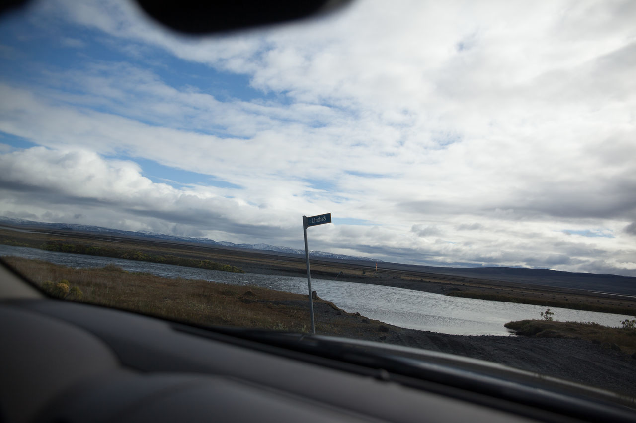 Lake And Landscape Seen Through Car Windshield