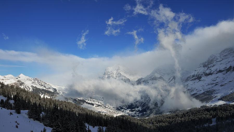 Kleine Scheidegg, above Grindelwald, Switzerland Alps Beauty In Nature Bernese Oberland Cloud Cloud - Sky Cloudy Grindelwald Kleine Scheidegg Landscape Majestic Mountain Mountain Range Outdoors Scenics Sky Snow Swiss Switzerland Tranquil Scene Tranquility Weather Wengen