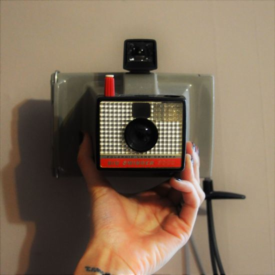Close-up Cropped Detail Equipment Hand Holding Indoors  Photography Themes Poloroid Product Photography Single Object Technology Camera Square