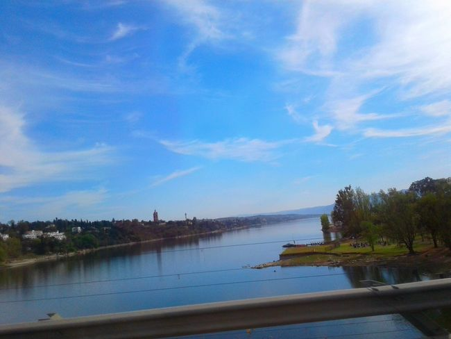 Carlos Paz - Córdoba - Argentina Water Sky Tranquil Scene River Blue Tranquility Tree Bridge - Man Made Structure Beauty In Nature Cloud Nature Day Calm Coastline Waterfront Primavera Verde Tree Reflexes