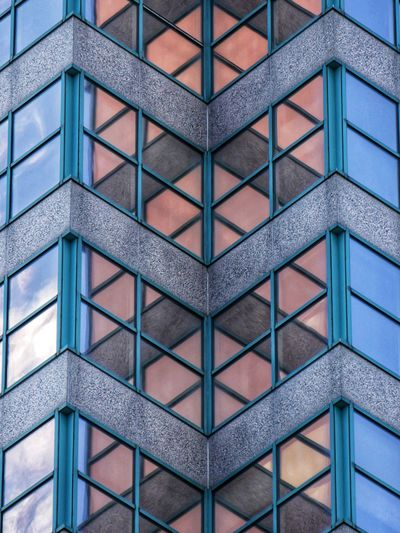 Walking around downtown Architecture Built Structure Building Exterior Building Full Frame Pattern No People Day Glass - Material Window Backgrounds Geometric Shape Shape Office Building Exterior Low Angle View Outdoors Reflection Design City Modern Apartment