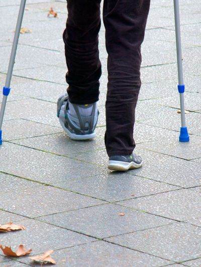 Crutches Day Human Body Part Human Leg Hurt Leg Limping Low Section One Person Outdoors Real People Shoe Sidewalk Standing Walking