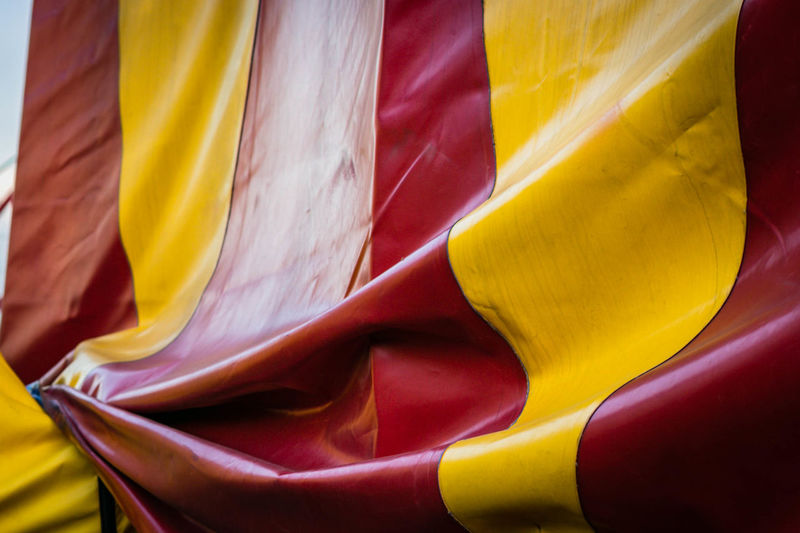 Circus Abstract Backgrounds Choice Close-up Day Flag Full Frame Material Multi Colored No People Outdoors Patriotism Pattern Red Store Textile Vibrant Color Wind Yellow