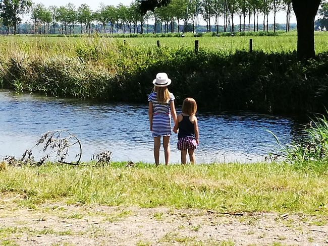 """""""One sisterbond"""" Wageningen view Water Togetherness Grass Summer People Day Standing Adult Outdoors Bonding Men Full Length Lake Leisure Activity Plant Young Adult Women Adults Only Nature Young Women"""
