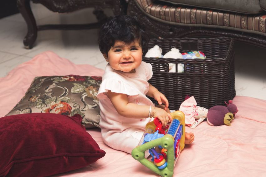 Iiving Room Home Pink Baby Girl Girl Childhood One Person Child Real People Indoors  Smiling Cute Toy Furniture Home Interior Happiness Emotion Sitting Baby Clothing Full Length Portrait Innocence