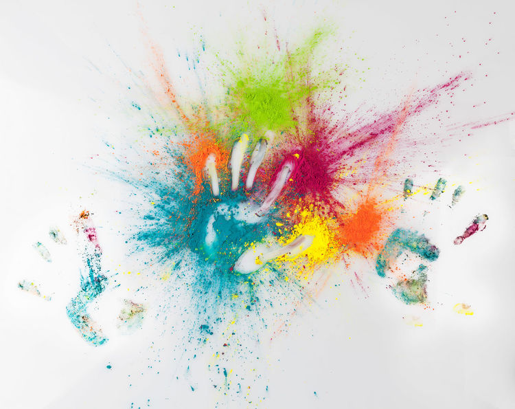 Hand imprints on colorful Holi powder. Happy Holi concept. Holi Festival Abstract Close-up Color Explosion Colorful Exploding Hand Imprint Holi Holi Powder Ink Multi Colored No People Paint Powder Paint Smudged Studio Shot Talcum Powder Vibrant Color White Background Yellow