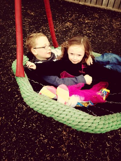 Relaxing cousins in the playground