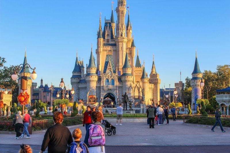 A day with family Tourism Vacations Family Castle Disney Architecture Building Exterior Built Structure Group Of People City Crowd Travel Destinations Sky Real People Building Travel Large Group Of People Tower Outdoors