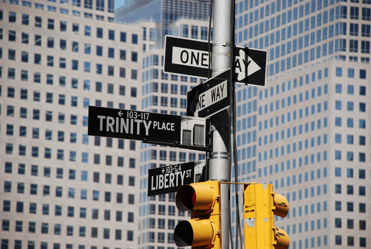 America Architecture Background Built Structure City City Life Close-up Communication Complicated Day Directions Financial District  Guidance Low Angle View Manhattan New York City No People One Way Outdoors Road Sign Stoplight Street Signs Urban USA